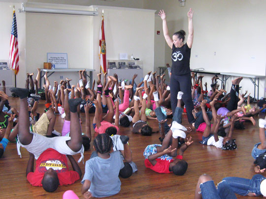 Instructor leading a yoga class for kids